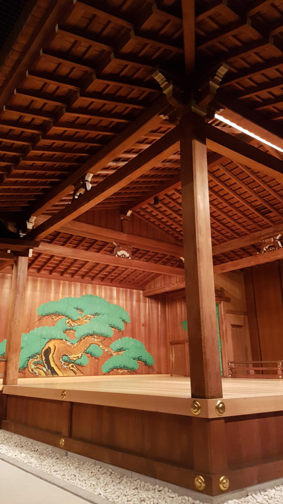 """A ground level view looking up towards the noh stage from the """"eye-fixing"""" pillar"""