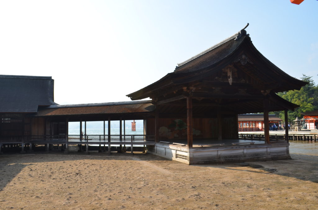 A roof covers the bridgeway and the mainstage of the outdoor nogaku stage at Itsukushima Shrine