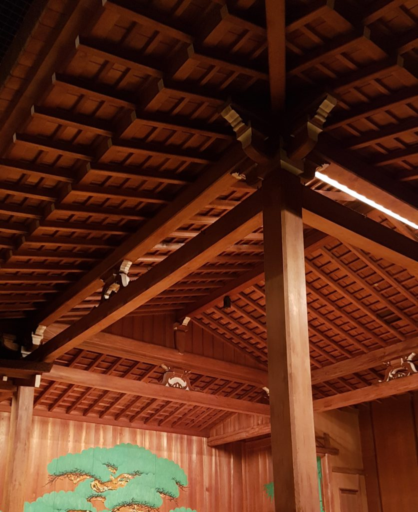A view of the underside of a nogaku stage roof that shows the many crossbeams running from the center outward